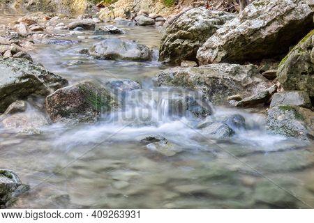 River Waterfall Stream Rocks Flow. Mountain River. River Creek Stream
