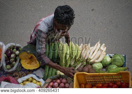 Bangalore, India, August, 2014 : Street Vendor Selling Vegetables In Bangalore India