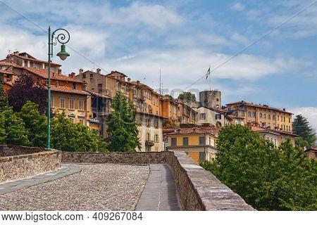 View Of The Old Cobblestone Road To Upper Bergamo (citta Alta). Bergamo Is A City In The Alpine Lomb