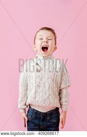 Playful Boy Standing Stiff And Tight, Mouth Open Wide, Shoulders Raised
