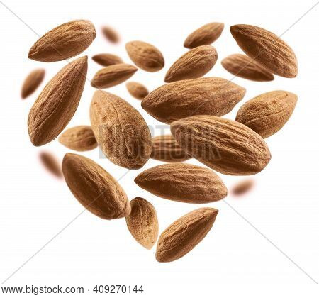 Almond Nuts In The Shape Of A Heart On A White Background