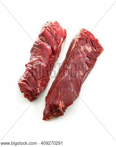 Two raw hanger steaks, also known as butchers steak or hanging tenderloin isolated on white background