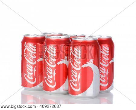 IRVINE, CA - January 05, 2014: A six pack of 12 ounce cans of Coca-Cola Classic, with wave and surfer design. Coca-Cola is the one of the worlds favorite carbonated beverages.