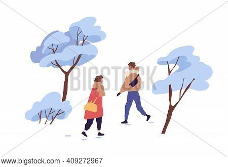 Happy People Walking Outdoor In Winter Among Trees Covered With Snow. Man And Woman Strolling In Par