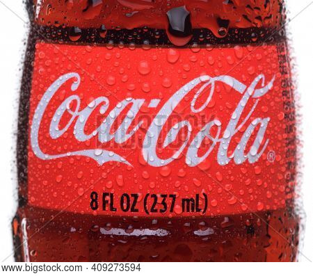 IRVINE, CA - February 14, 2013: Photo of an 8 ounce bottle of Coca-Cola Classic with condensatio. Coca-Cola is the one of the worlds favorite carbonated beverages.