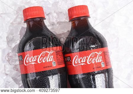 IRVINE, CALIFORNIA - January 22, 2017: Two bottles of Coca-Cola on ice. Coca-Cola is the one of the worlds favorite carbonated beverages.