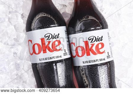 IRVINE, CALIFORNIA - January 22, 2017: 3 bottles of Diet Coke on ice. Coca-Cola is the one of the worlds favorite carbonated beverages.