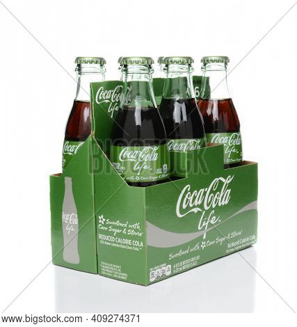 IRVINE, CA - FEBRUARY 15, 2015: 6 pack of Coca-Cola Life bottles. A reduced calorie soft drink sweetened with cane sugar and Stevia, containing 60% of the calories of Classic Coke.