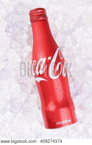 IRVINE, CALIFORNIA - JULY 10, 2017: Coca-Cola Aluminum Bottle on ice. Coke first introduced the aluminum bottle in 2015 claiming it is their hardest package to produce.