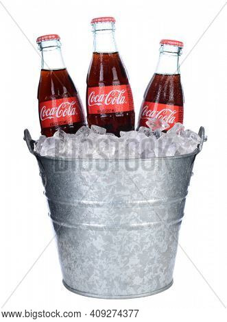 IRVINE, CA - February 06, 2014: Threes bottles of Coca-Cola in and Ice bucket. Coke is one of the most popular soft drinks in the world.