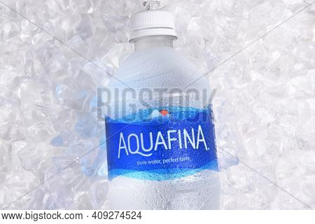 IRVINE, CALIFORNIA - JANUARY 22, 2017: Aquafina Water Bottle on ice. The purified water brand is produced by PepsiCo, in both flavored and unflavored varieties.
