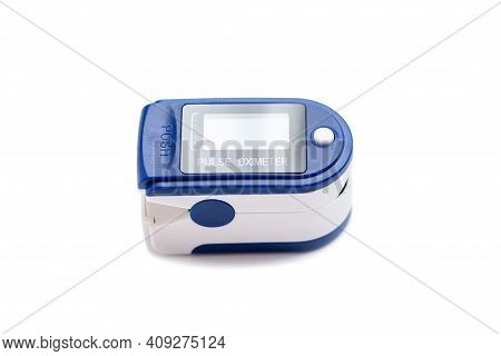 Portable Blue Pulse Oximeter On Isolated White Background With Clipping Path To Monitor Oxygen Level