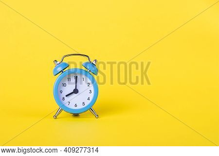 The Alarm Clock Shows 8 Am. Morning Time. Clock Face. Yellow Background, Deadline Concept. Copy Spac