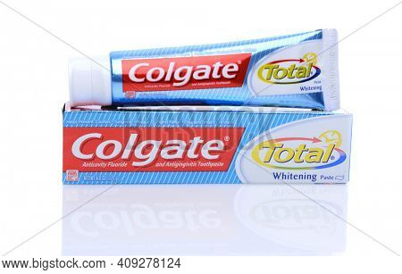 IRVINE, CA - May 14, 2014: A 6oz tube of Colgate Total Toothpaste. Colgate, a sub-brand of Colgate-Palmolive, is an oral hygiene product line of toothpastes, toothbrushes, mouthwashes and floss.