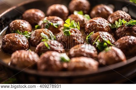 Detail Of Swedish Meatballs, Kottbullar, In A Pan Topped With Fresh Parsley.