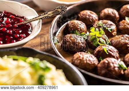 Swedish Food Kottbullar Meatballs, Served In A Pan With Mashed Potatoes, Parsley And Cranberry Sauce