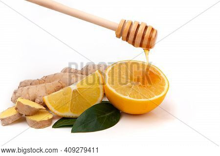 Isolated Pieces Of Ginger And Lemon With Honey . Natural Medicine, Anti-influenza And Antiviral Ingr