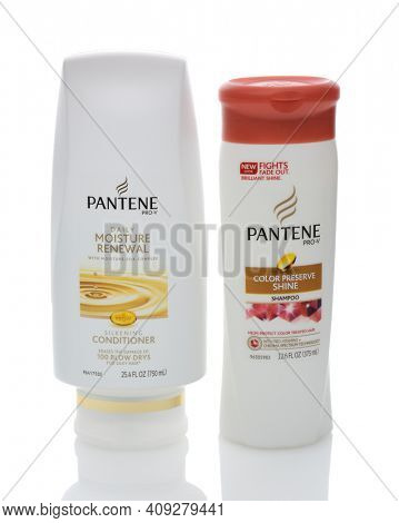 IRVINE, CA - DECEMBER 12, 2014: Two bottles of Pantene Hair Care Products. Introduced in Europe in 1947 by Hoffmann-La Roche of Switzerland, the name based on panthenol as a shampoo ingredient.