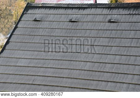 Roof Tiles Made Of Plastic Imitation Wooden Shingles. View Of Rows Of Gray Narrow Recycled Boards. V
