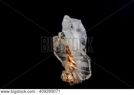 Macro Mineral Stone Flattened Crystal Of Rock Crystal On A Black Background