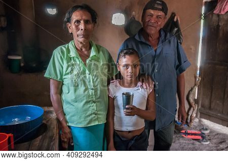 Rivas, Nicaragua. 07-15-2016. Grandparents And Their Grand Daughter In Their House In An Rural Area