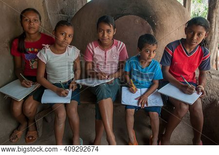Rivas, Nicaragua. 07-15-2016. Children Doing Their Homework In A Rural Area Of Nicaragua. The Have T