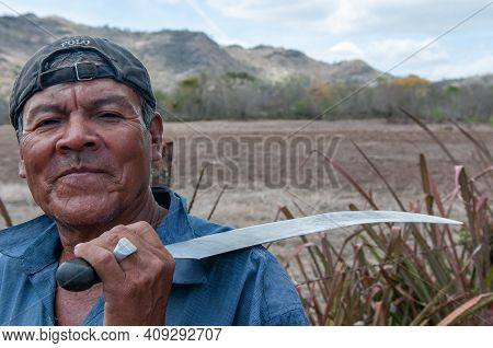 Rivas, Nicaragua. 07-15-2016. Portrait Of A Farmer With His Knife In A Rural Area Of Nicaragua. Fami