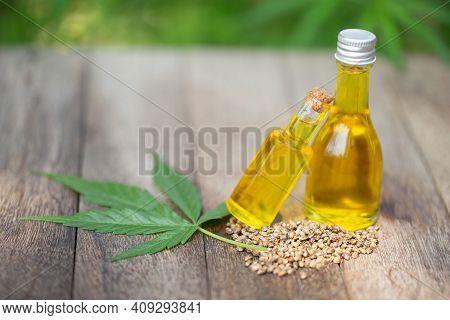 Cbd Hemp Oil In A Glass Jar, Cannabis Leaves And Cannabis Seeds Cannabis Oil Concept By Researchers