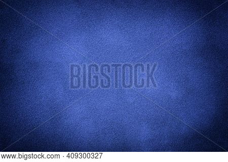Navy Blue Matte Background Of Suede Fabric With Vignette, Closeup. Velvet Texture Of Seamless Indigo