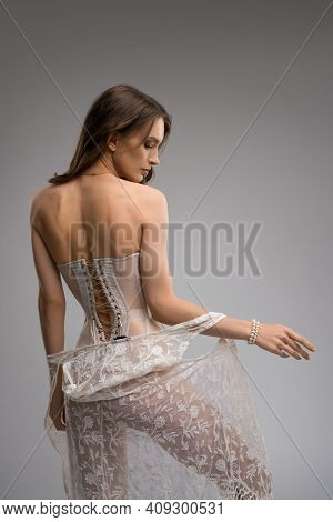 Alluring Young Woman In Elegant Stylish Corset And Peignoir