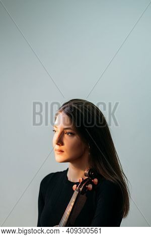 Female Violinist Portrait. Musician Artist. Hobby Amusement. Professional Photo Session. Beautiful W