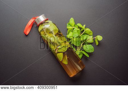 Kombucha Tea Super Food Pro Biotic Beverage In Glasses With Mint On Wooden Background - Homemade Hea