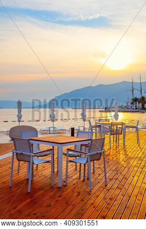 Open air cafe by the sea at sunset, Tivat,  Montenegro