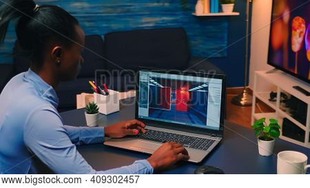 Young African Woman Gamer Testing Online Professional Game On Laptop At Home Late At Night. Professi