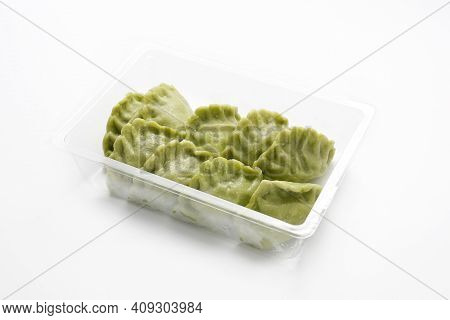 Green, Spinach Pierogi, Dumplings On A Plastic, Transparent Food Tray, Isolated On A White Backgroun