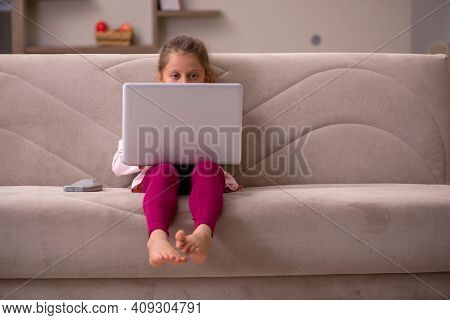 Small girl in tele-education concept at home