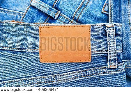 Denim Texture, Blue Jeans And Blank Leather Label, Close Up Of Comfortable Casual Pants And Clothes.
