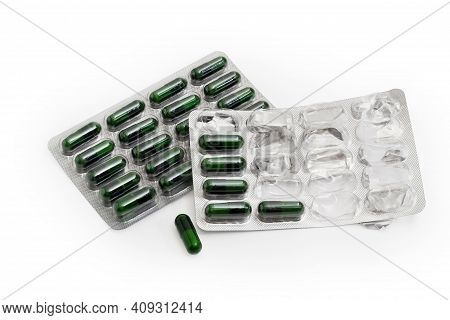 Pharmaceutical Drugs In The Form Of Dark Green Capsules In The Full Blister Packing And In Started P