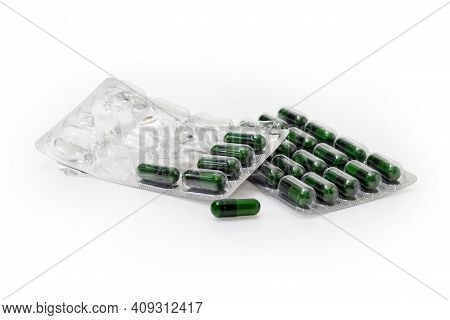 One Full Blister Packing And One Started Packing With Pharmaceutical Drugs In The Form Of Dark Green