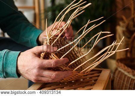 Man Weaving Wicker Basket Indoors, Closeup View