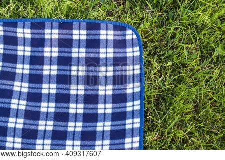 Outdoor Picnic Concept. Mock Up With Empty Picnic Blanket On The Green Grass. Copy Space, Close Up,