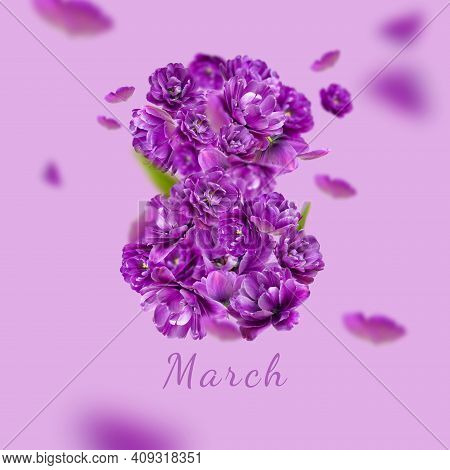 Concept Of 8 March Holiday. Numeral 8 From Lilac Purple Tulips On Purple Background. International W