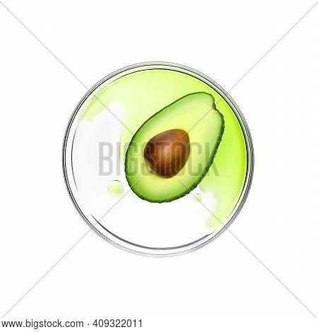 Fresh Avocado With Essence On Petri Dish Over White Background