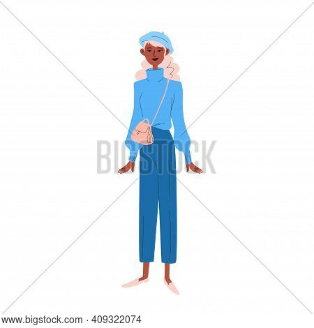 A Young Woman In Blue Clothes With A Beret On Her Head And A Small Handbag Over Her Shoulder. A Dark
