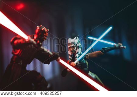 FEB 20 2021: Scene from Star Wars The Clone Wars with Darth Maul battling Ahsoka Tano during the siege of Mandalore - Hasbro action figure
