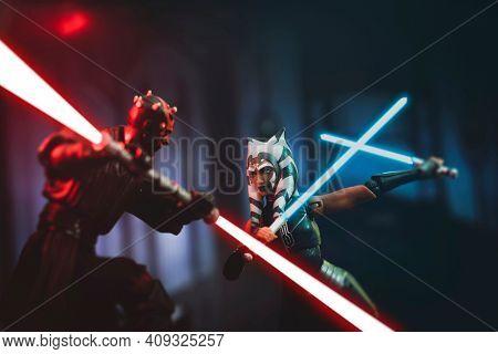 FEB 20 2021: Scene from Star Wars The Clone Wars with Darth Maul battling Ahsoka Tano during the siege of Mandalore - Hasbro action figure