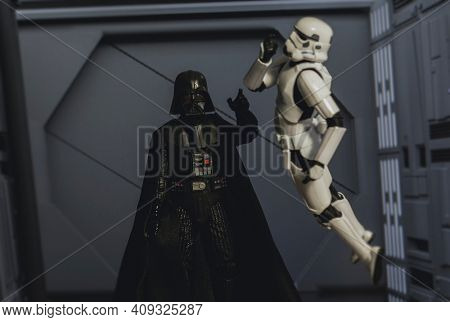 FEB 20 2021: Star Wars Sith lord Darth Vader force choking a disobedient Stormtrooper - Hasbro action figure