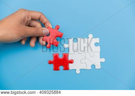 Jigsaw Connection Between White And Red Jigsaw Puzzles, Jigsaw Puzzle In The Hand Of A Businessman,