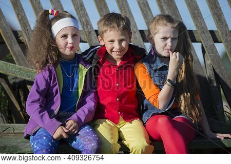 Funny Little Children: Girls With Bright Makeup Dressed In The Style Of The Nineties And A Boy In A