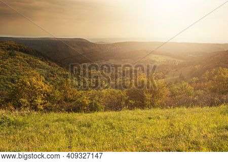Green Field And Hilly Landscape During Autumn.scenic View.